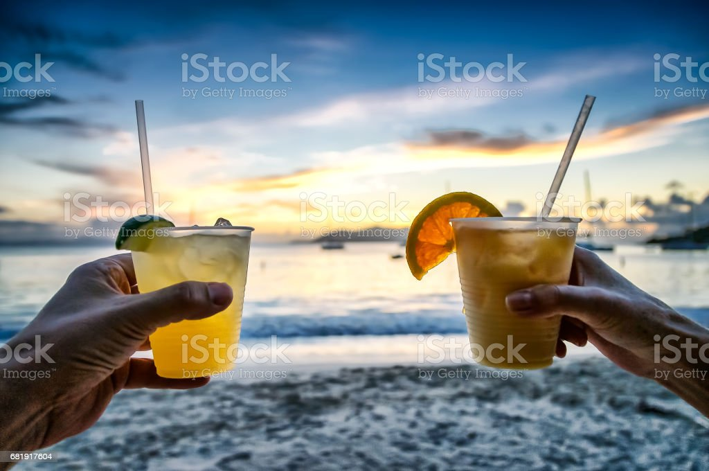 Margarita cocktail drinks at sunset on the beach stock photo