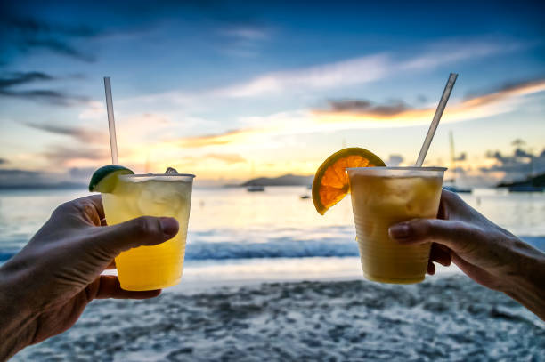 margarita cocktail drinks at sunset on the beach - margarita drink stock photos and pictures