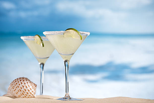 margarita  cocktail on beach, blue sea and sky background stock photo