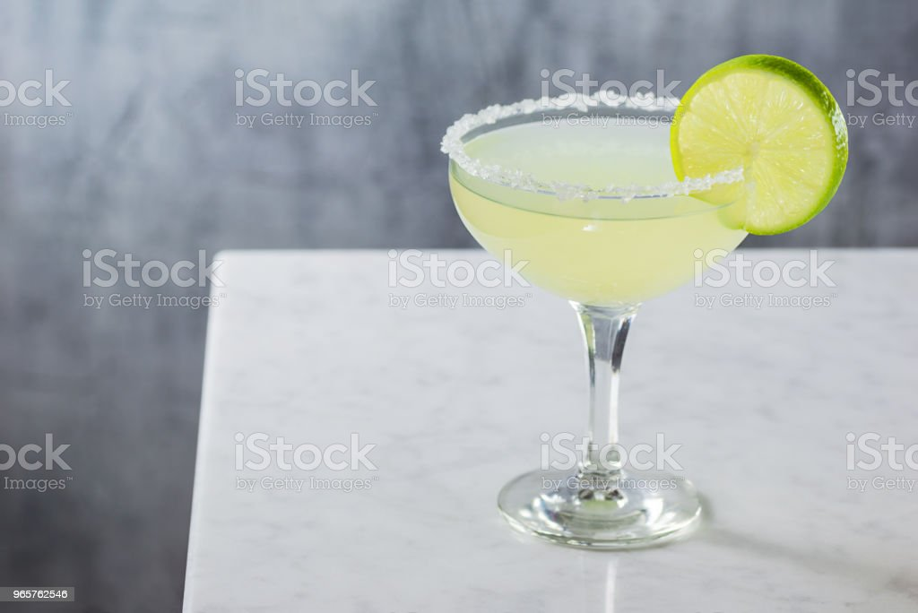 Margarita Cocktail Straight Up in Goblet with Salted Rim on Marble Counter stock photo