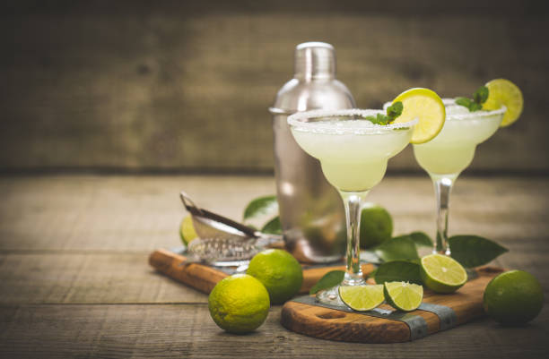 margarita cocktail with lime and mint - margarita drink stock photos and pictures