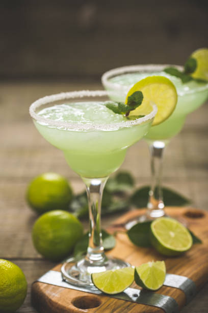 Margarita cocktail with lime and mint Margarita cocktail with lime and mint margarita stock pictures, royalty-free photos & images