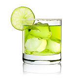 Photography of a classic Margarita with ice nuggets, salt-rand and lime decoration.