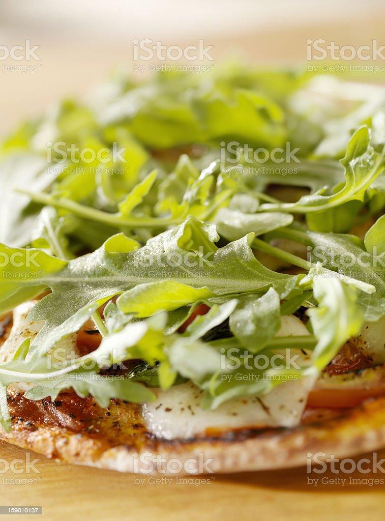 Margharita Pizza with Arugula on Flat Bread royalty-free stock photo