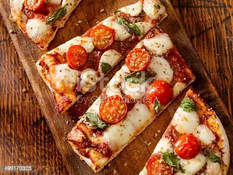 Margherita Pizza with Fresh Mozzarella,Tomatoes and Basil on Thin Flat Bread - Photographed on a Hasselblad H3D11-39 megapixel Camera System