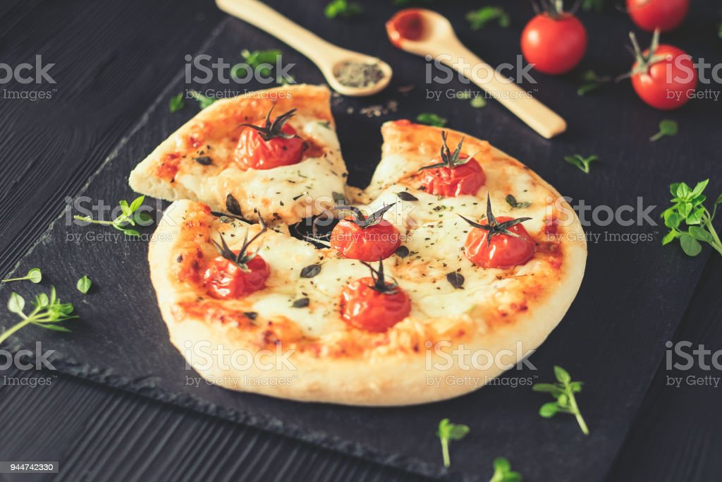 Margherita home made pizza on dark table stock photo