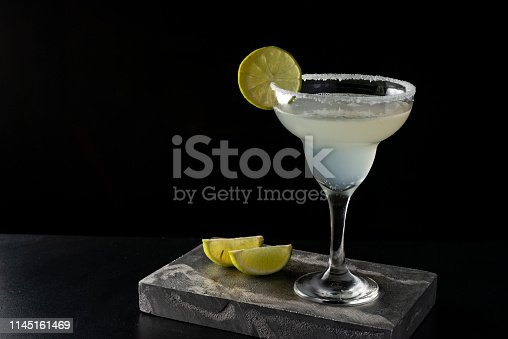 Marguerita cocktail is on the bar. Space for text. Photo for the menu.