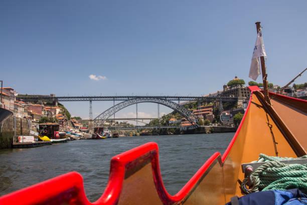 Maria Pia Bridge seen from a tourist boat on the river Douro, Porto stock photo