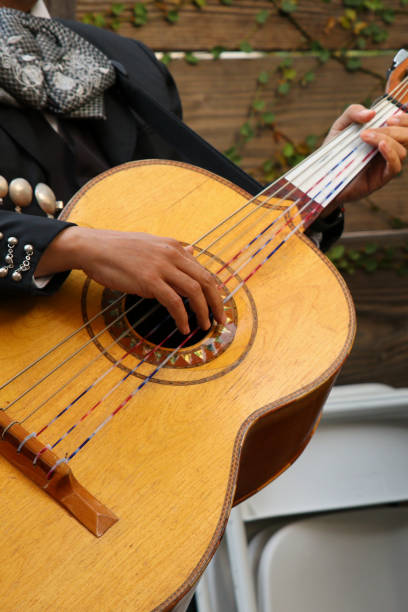 Mariachi performer playing guitar close up stock photo