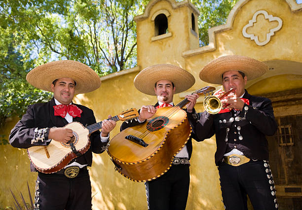 Mariachi Three Mariachi playing instruments serenading stock pictures, royalty-free photos & images