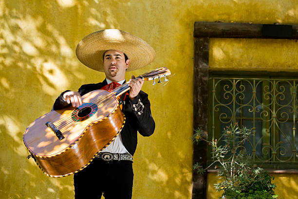 Mariachi Playing Guitar  serenading stock pictures, royalty-free photos & images