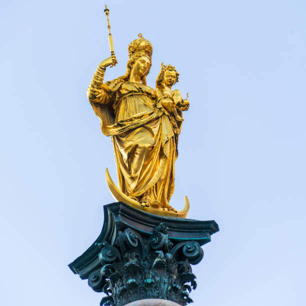 Marian column (1639) or Mariensaule with golden statue of Virgin Mary, Munich, Germany stock photo