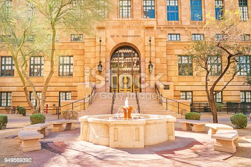 Stock photograph of fountain and the Maricopa County Courthouse in Phoenix Arizona USA on a sunny day.