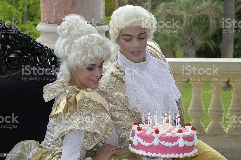 Marie Antoinette and partner with cake stock photo