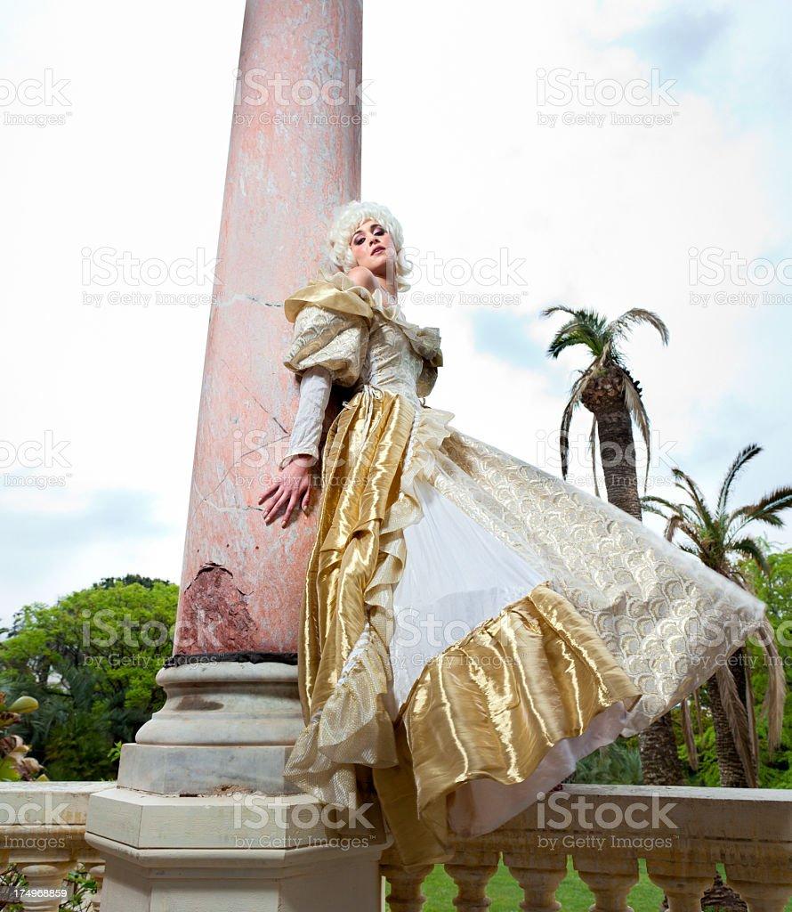 Marie Antoinette leaning against marble column stock photo