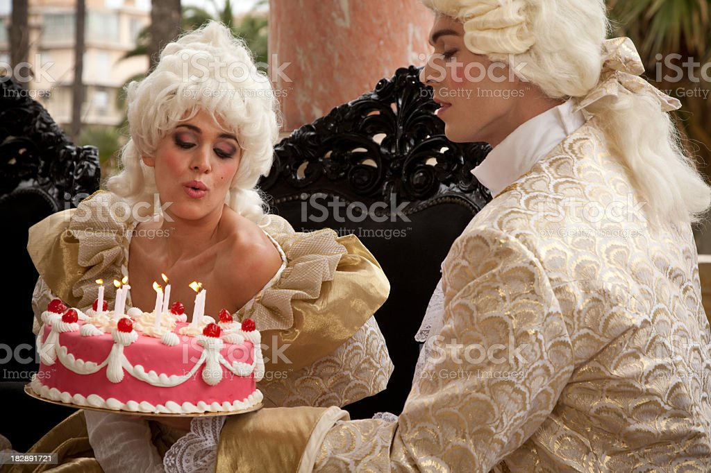 Marie Antoinette receiving a cake from her Prince stock photo