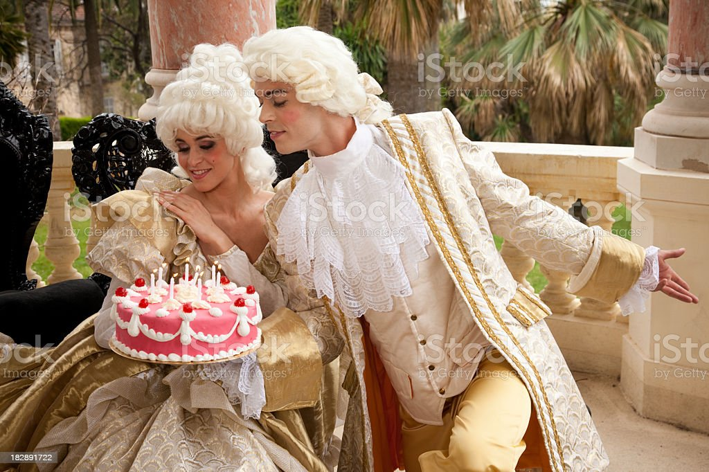 Marie Antoinette receiving a cake from her Prince royalty-free stock photo