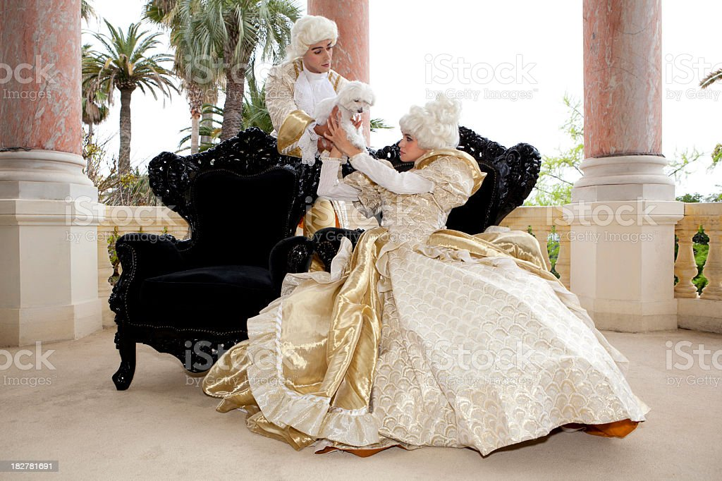 Marie Antoinette receiving a cute pet stock photo