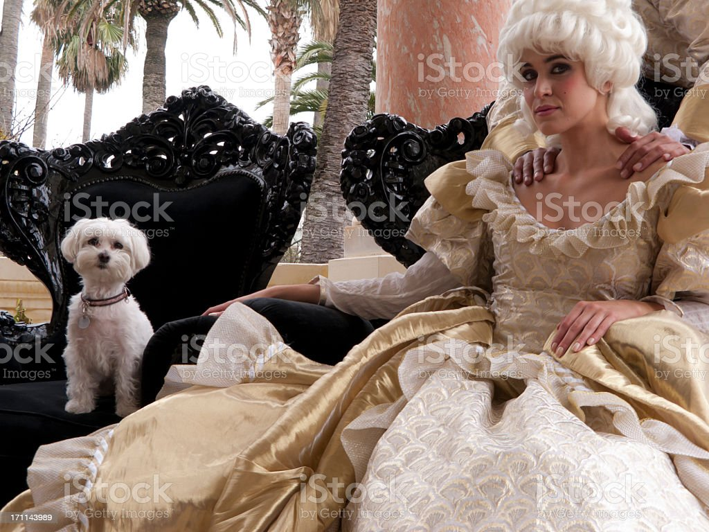 Marie Antoinette sitting outside with her pet stock photo