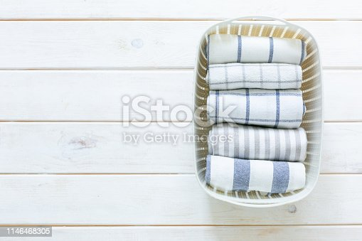 istock Marie Kondo tidying concept - folded kitchen linens in white basket 1146468305
