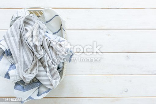 istock Marie Kondo tidying concept - folded kitchen linens in white basket 1164403335