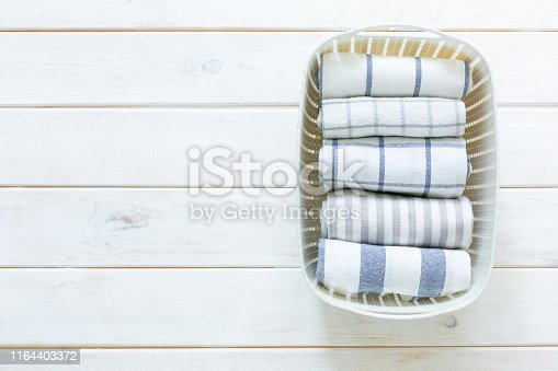 istock Marie Kondo tidying concept - folded kitchen linens in white basket 1164403372