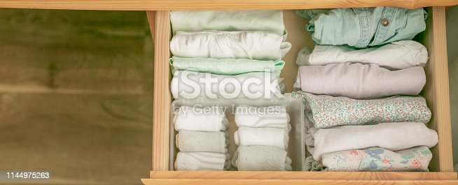 istock Marie Kondo tyding up method concept - folded clothes 1144975263