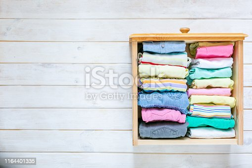 1164401360 istock photo Marie Kondo tyding up method concept - folded clothes 1164401335