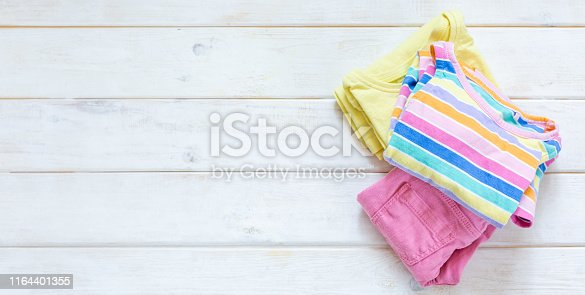 1164401360 istock photo Marie Kondo tyding up method concept - folded clothes 1164401355