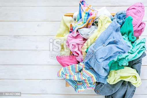 1164401360 istock photo Marie Kondo tyding up method concept - folded clothes 1164401366