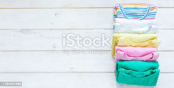 1164401360 istock photo Marie Kondo tyding up method concept - folded clothes 1164401399