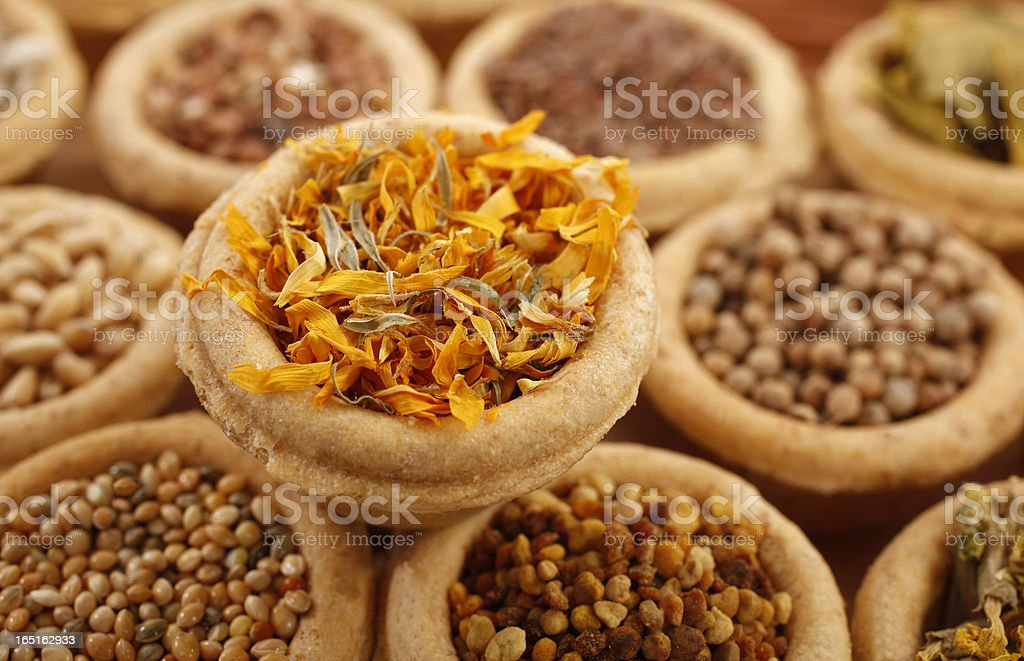 Marigold petals dried and other spices royalty-free stock photo