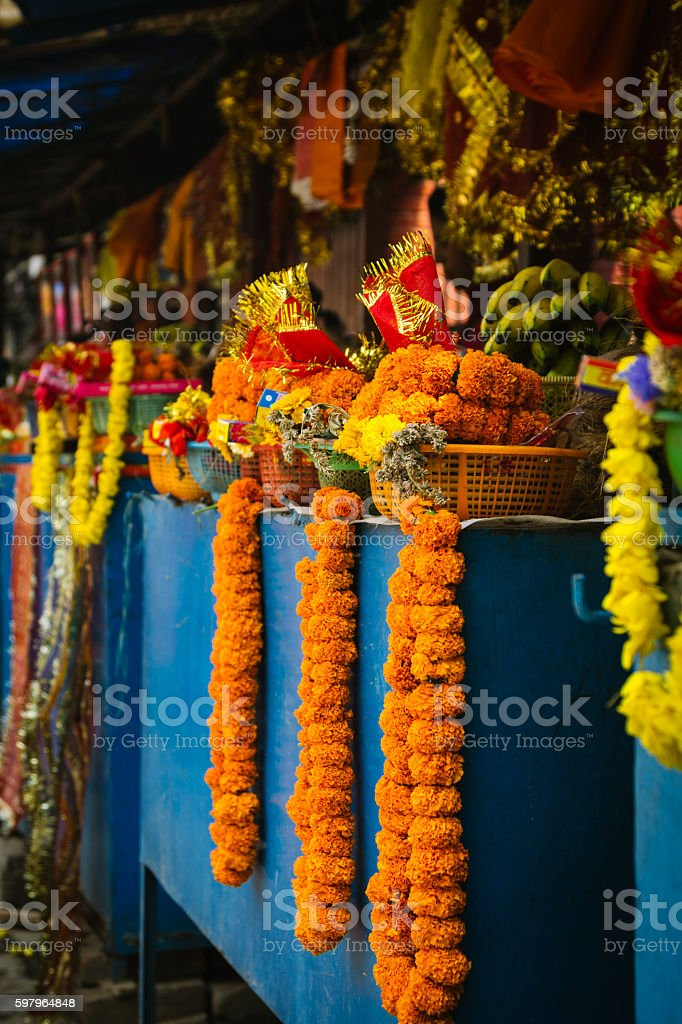 Marigold votive offerings for sale at a Hindu Temple stock photo