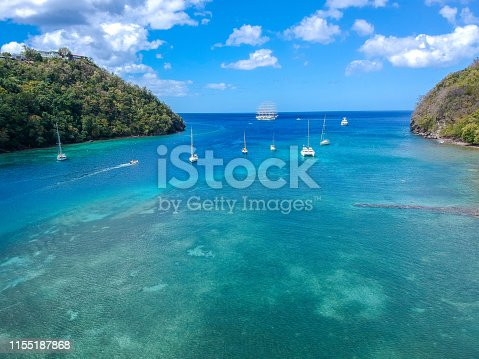 Stills shot from Drone of the beautiful Marigot bay detailing detailing boats, blue skies, fluffy clouds and Caribbean Sea.