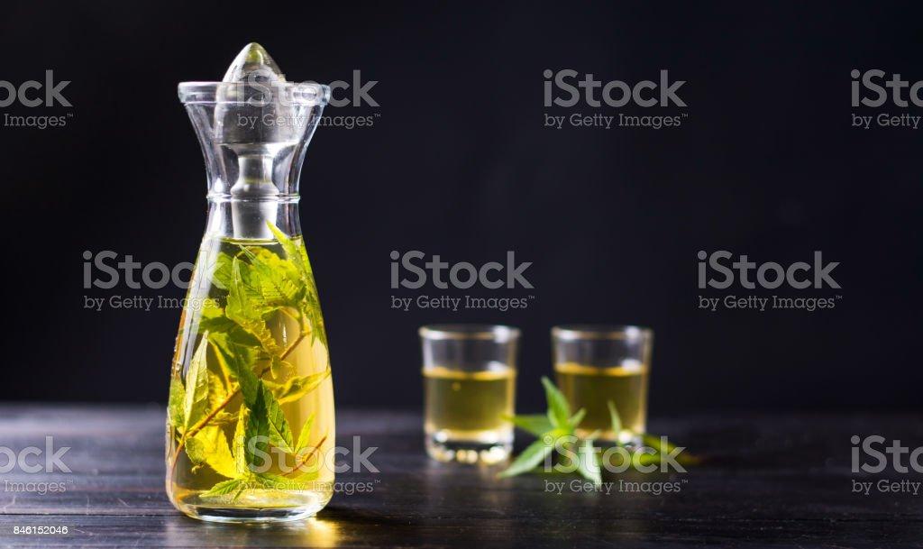 Marijuana alcohol drink in a bottle stock photo