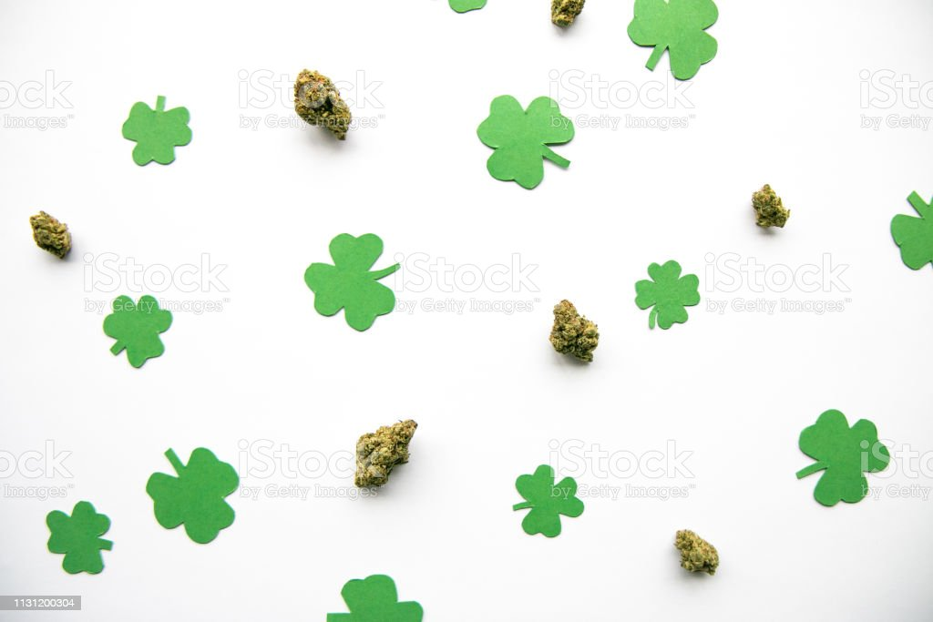 Marijuana Buds against Four and Three Leaf Clovers St Patricks St Pattys Day - Top Down, Left Aligned View stock photo