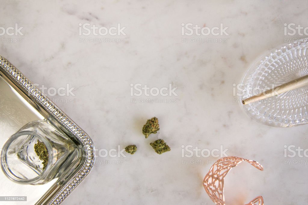 Marijuana Buds, Joint and Jar on Marble Vanity Top Down Luxury Cannabis stock photo
