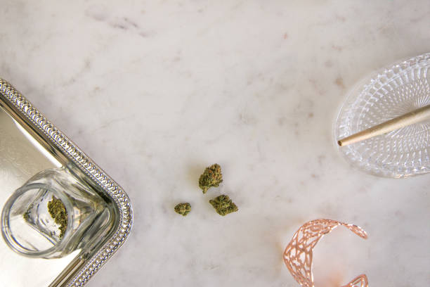Marijuana Buds, Joint and Jar on Marble Vanity Top Down Luxury Cannabis stock photo