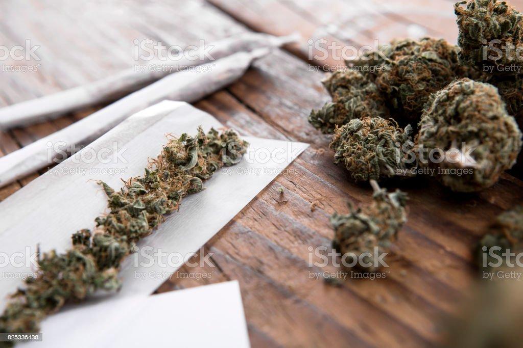 Marijuana buds with marijuana joints stock photo