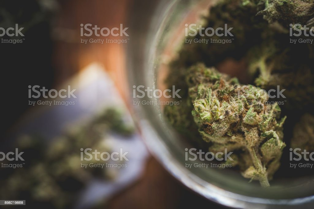 Marijuana in a jar. Cannabis joint. Medical or recreative stock photo
