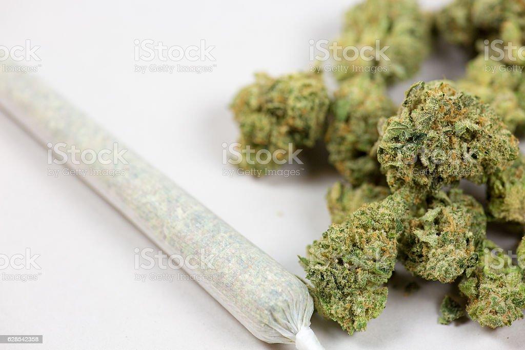 Marijuana joint and bud close up shot stock photo