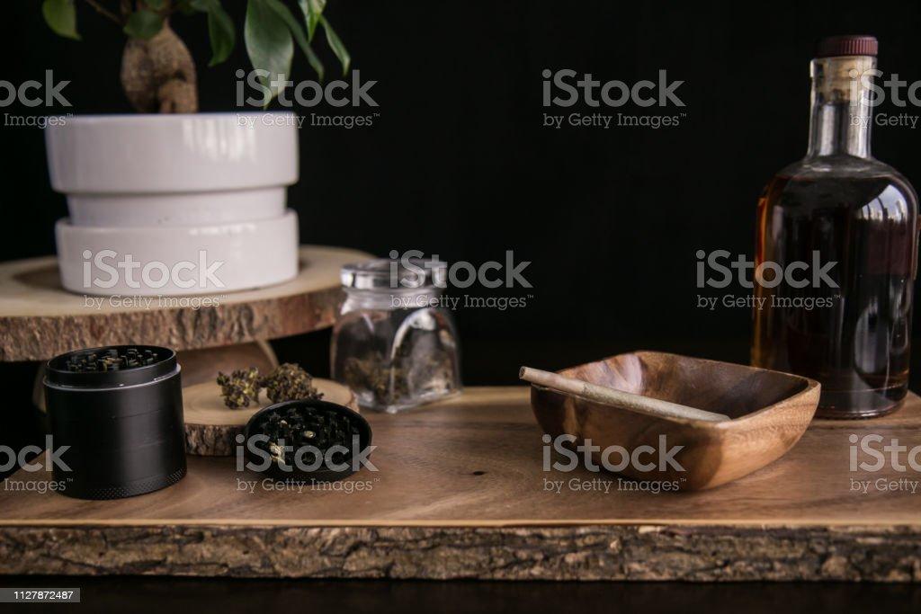 Marijuana Joint, Buds and Grinder on Wood Background Luxury Cannabis stock photo