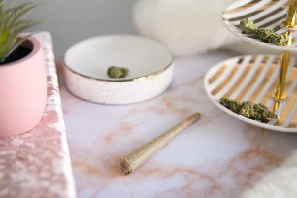 Marijuana Joint on Pink Marble Vanity Luxury Cannabis stock photo