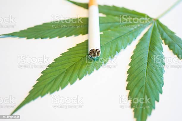 Marijuana Leaf And Cigarette Stock Photo - Download Image Now