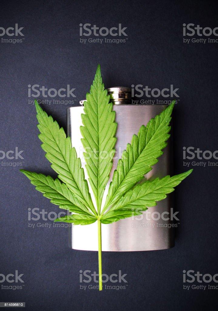 Marijuana leaf on a hip flask stock photo