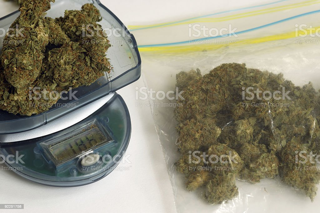 Marijuana on scale and a bag of Marijuana stock photo