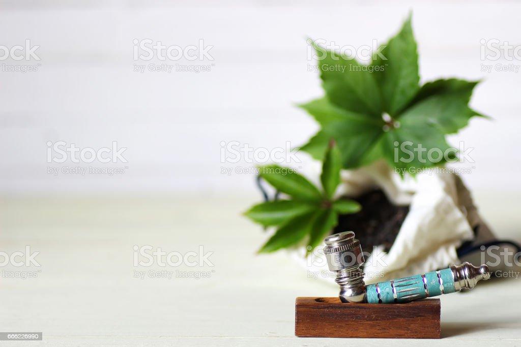 marijuana pipe background stock photo