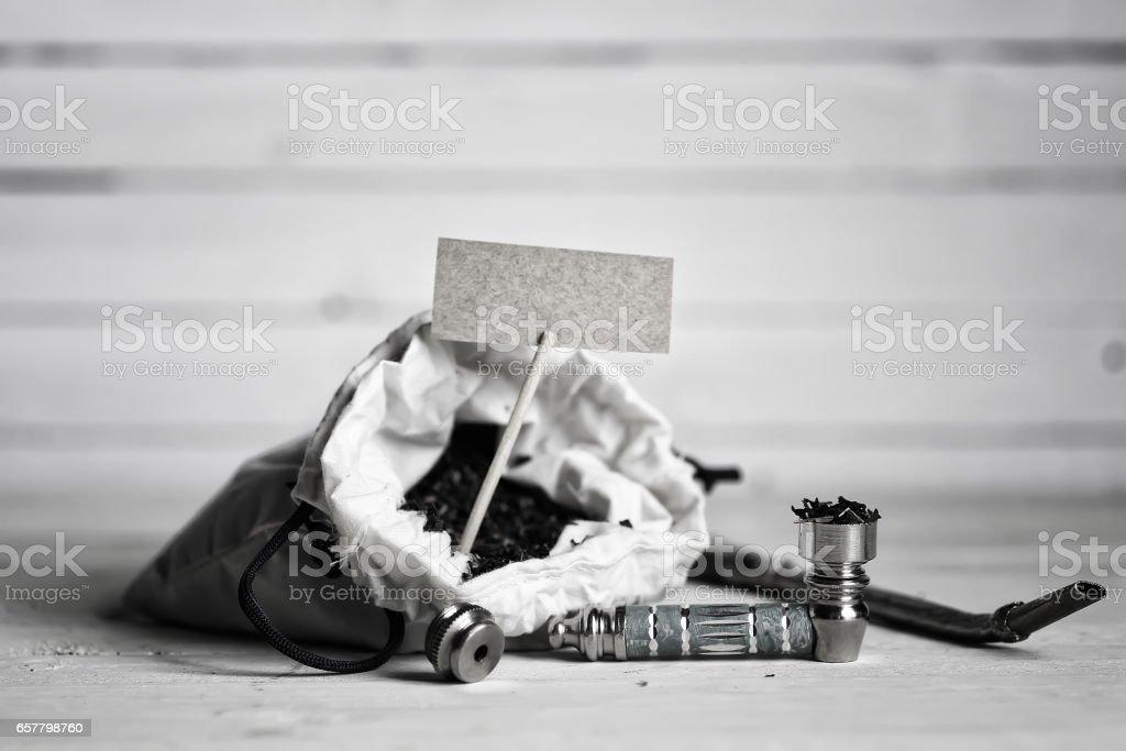 marijuana pipe on wooden background stock photo