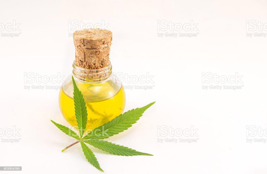 marijuana plant and cannabis oil stock photo