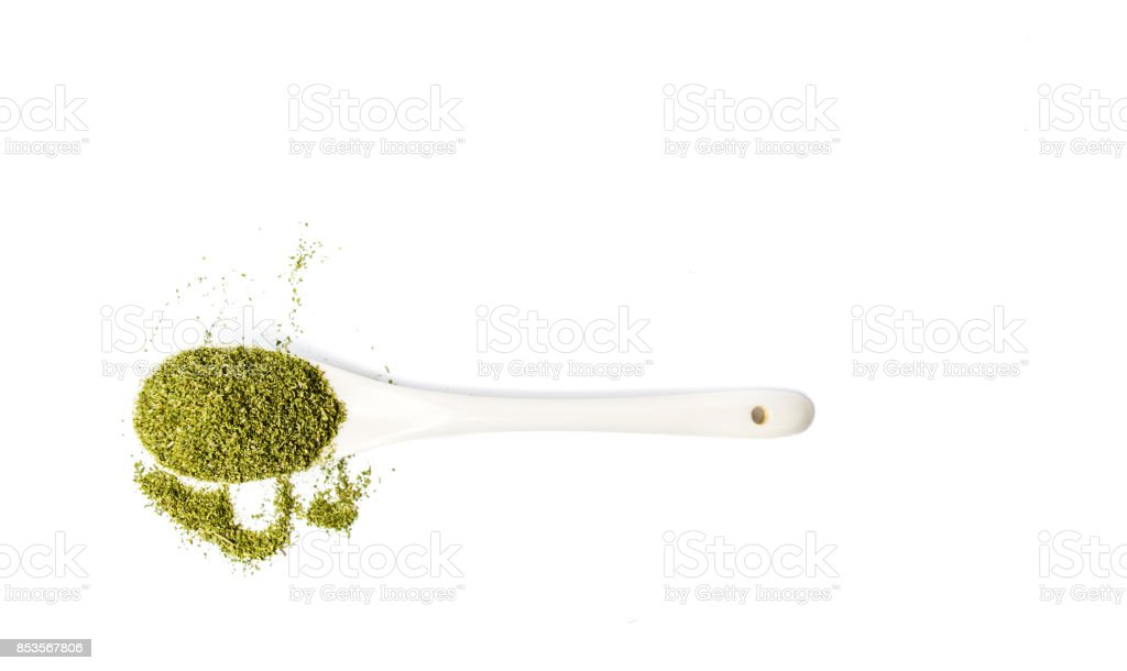 Marijuana powder of dried cannabis leafs in a spoon stock photo